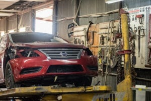 Fort Worth Auto Body Repair- action photo- car lift