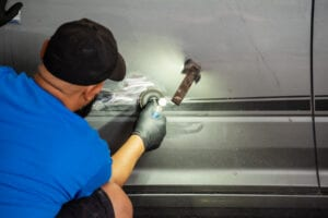 Fort Worth Auto Body Repair- action photo- dent removal